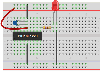 Blinking LED circuit with PIC18F1220 breadboard schematic